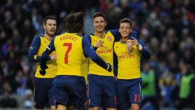 Mesut Ozil: Celebrates with his team-mates after scoring Arsenal's second goal.