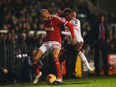 Kelvin Wilson holds off Hugo Rodallega