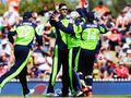 Ireland's George Dockrell celebrates the wicket of Marlon Samuels