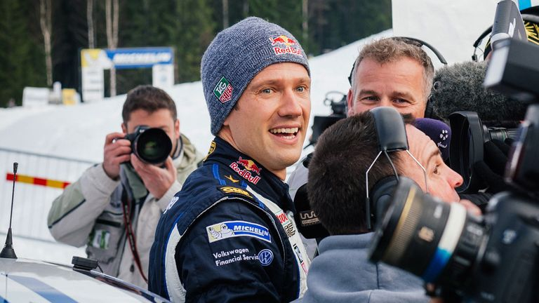 Sebastien Ogier of France (C) celebrates