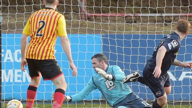 Craig Curran (r) fires Ross County ahead against Partick Thistle at Firhill