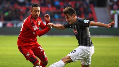 Christian Gunter of Freiburg  challenges Karim Bellarabi