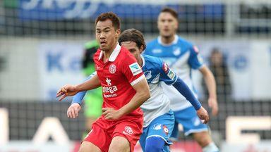 Shinji Okazaki of Mainz is challenged by Sebastian Rudy