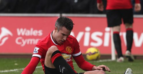 Robin van Persie of Manchester United lies injured