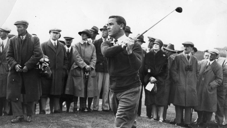 Gene Sarazen of the USA taking a shot, surrounded by spectators.