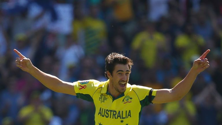 Mitchell Starc celebrates taking the wicket of Brendon McCullum in the World Cup final