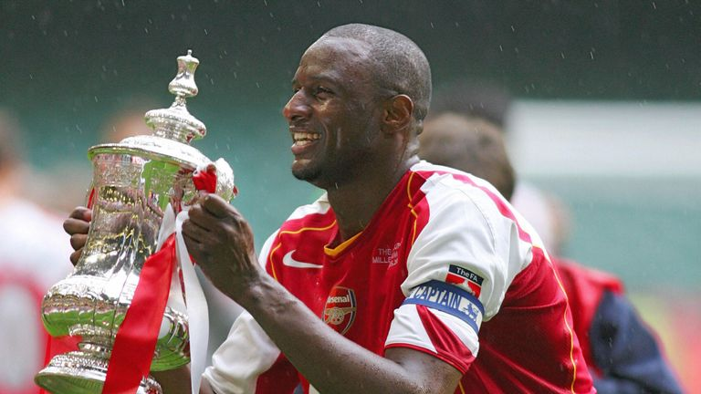 Arsenal's Patrick Vieira lifting the FA Cup after their penalty shootout win over Manchester United in 2005
