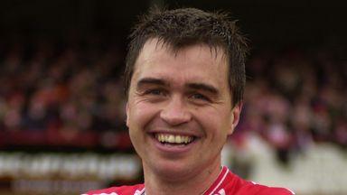 Russell Milton Cheltenham boss in the absence of Gary Johnson.