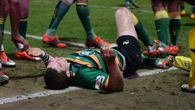 George North of Northampton Saints lays injured after colliding with Nathan Hughes of Wasps