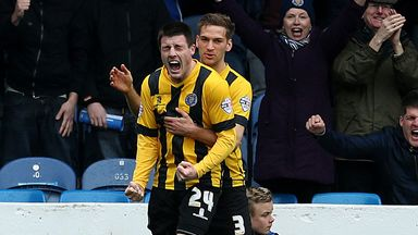 Bobby Grant celebrates after scoring for Shrewsbury at Portsmouth