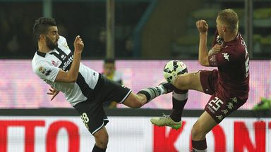 Massimo Coda and Kamil Glik tangle