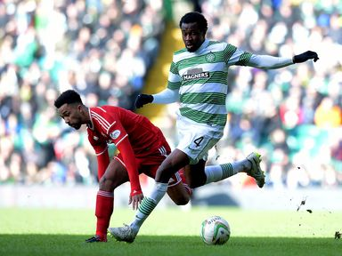 Efe Ambrose takes the ball away from Shay Logan
