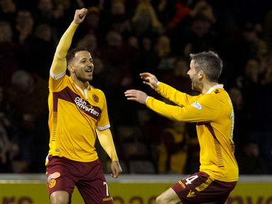 Lionel Ainsworth celebrates opening the scoring with Motherwell captain Keith Lasley