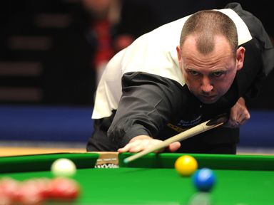 Mark Williams of Wales in action during his quarter-final match against Mark Selby of England at Alexandra Palace on January