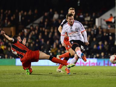 Ross McCormack of Fulham shoots past Tommy Elphick