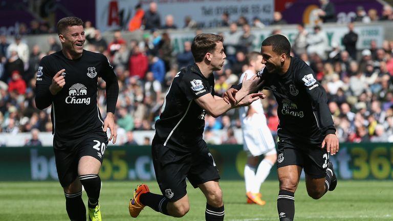 Aaron Lennon of Everton celebrates scoring the opening goal against Swansea
