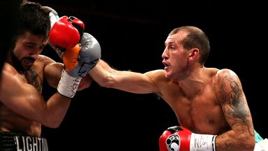 Derry Mathews (R) connects with David Luiz en route to interim world lightweight title win