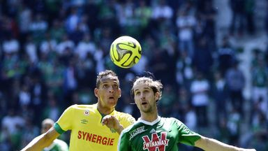 Saint-Etienne defender Francois Clerc (R) vies with Nantes' Yacine Bammou.