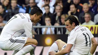 Gareth Bale tells Cristiano Ronaldo of his injury early in the game against Malaga