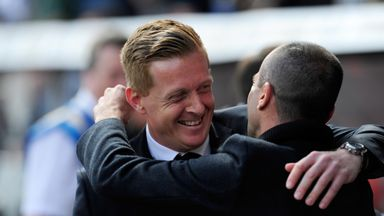 Garry Monk (left) is all set for another meeting with Roberto Martinez