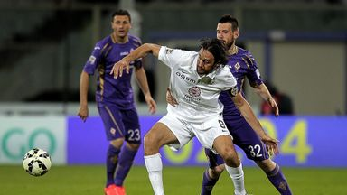 Manuel Pasqual battles for the ball with Luca Toni