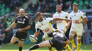 Wesley Fofana offloads the ball despite Marcelo Bosch's tackle