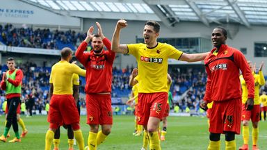 Craig Cathcart (centre) celebrates with Watford team mates and fans.