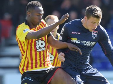 Partick Thistle's Abdul Osman battles for the ball with Filip Kiss (right)