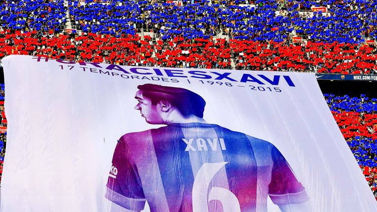 Barcelona fans display a huge banner tribute to Xavi before his final La Liga match