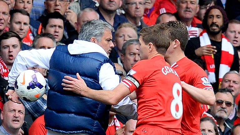 Then-Chelsea manager Mourinho keeps the ball away from Liverpool players