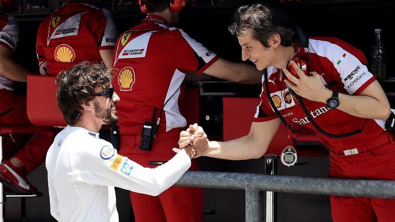 Fernando Alonso greets his former Ferrari colleague Massimo Rivola