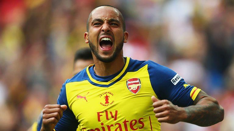 Walcott: celebrates scoring the opener against Villa at Wembley