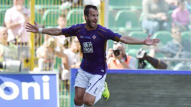 Alberto Gilardino of Fiorentina celebrates scoring against Palermo.