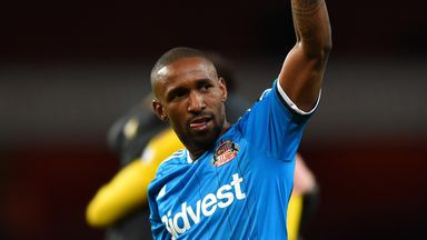 Jermain Defoe acknowledges the Sunderland fans after a draw at Arsenal secured survival