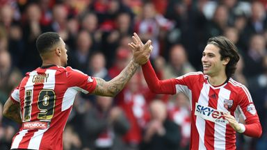 Jota (right) celebrates his goal with Andre Gray