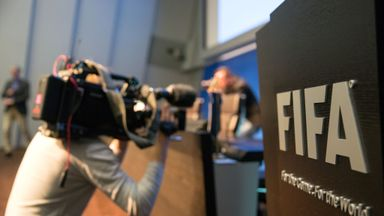 A cameraman attends a press conference  at the FIFA headquarters in Zurich, Switzerland following news of Wednesday's arrests.