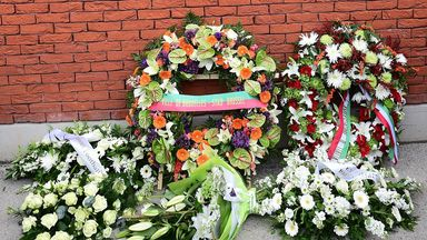 Floral tributes are laid at the foot of the Heysel memorial plaque at Anfield