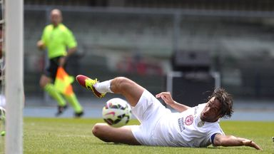 Luca Toni watches the ball go by