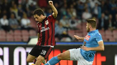 Giacomo Bonaventura of Milan and David Lopez of Napoli tussle for the ball