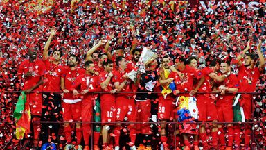 Sevilla's players celebrate with the Europa League trophy