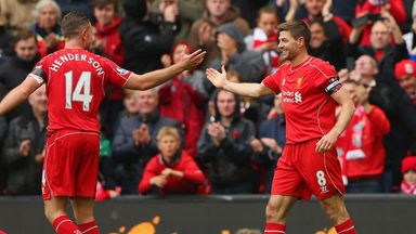 Liverpool captain Steven Gerrard celebrates with Jordan Henderson