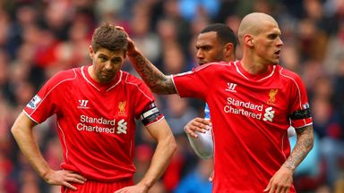Steven Gerrard is consoled by Martin Skrtel after missing his penalty against QPR.