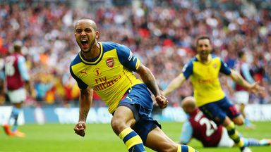 Theo Walcott: Celebrates scoring the opener for Arsenal.
