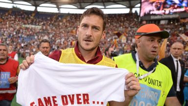 Francesco Totti celebrates with a shirt reading 'game over' after the final whistle