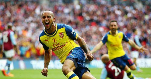 Theo Walcott: Celebrates scoring the opener for Arsenal.