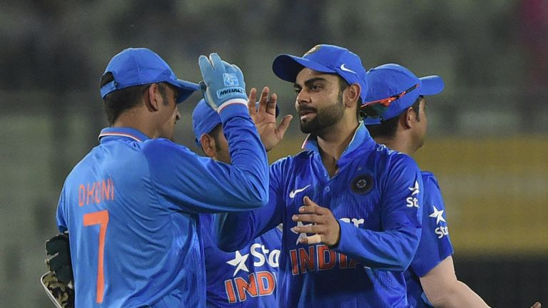 Vrat Kohli (R) looks the man most likely to take over from Dhoni (L)