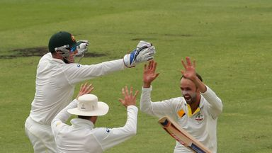 Nathan Lyon celebrates after taking the wicket of Graeme Swann at Perth in 2013