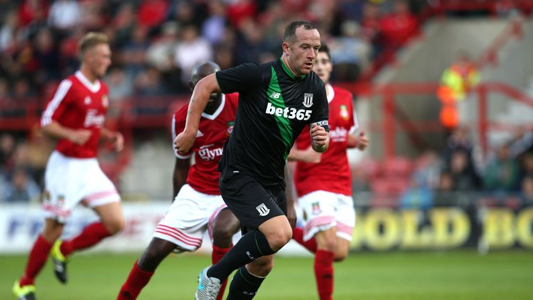 Charlie Adam (front) misses Stoke's FA Cup tie with a calf injury