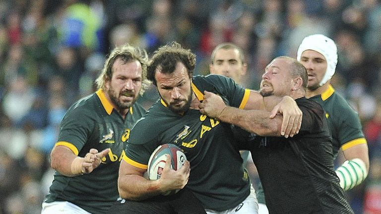 Bismarck du Plessis takes the ball up against the All Blacks defence