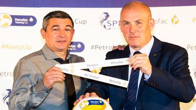 Mark Warburton (right) with former Rangers player Charlie Miller at the Petrofac Training Cup draw at Hampden Park